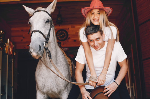 beautiful-couple-spend-time-with-a-horse