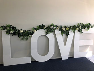 LOVE letters with floral garland