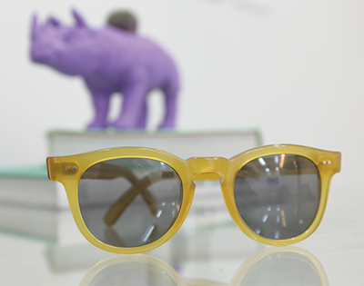 Yellow sunglasses on table
