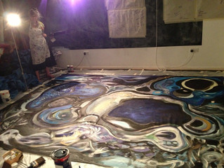 Artist Susan Sowerby working on the stage cloths