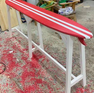 SURFBOARD TABLE WITH A WOOD FRAME