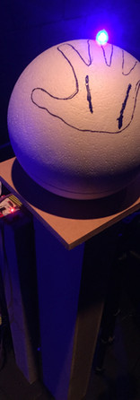 Each orb is on a platform, with electric paint connection