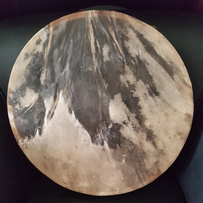 shamanic drum showing naturally occurring image of horse's head, mane and feathers