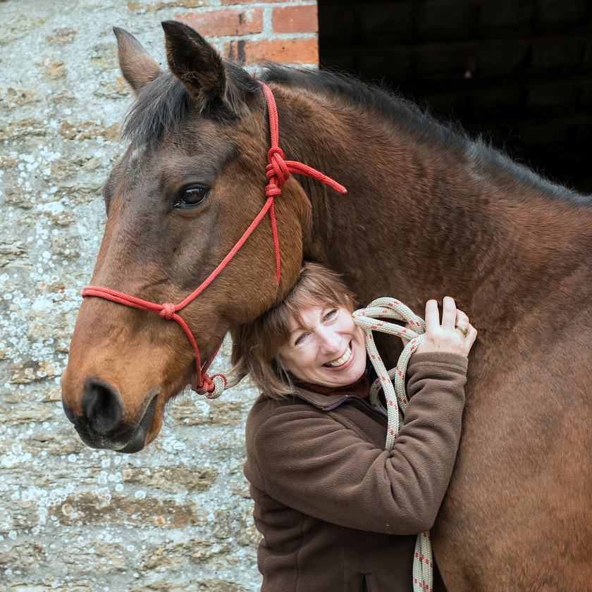 Diana with her horse Chiquita, a thoroughbred bay mare