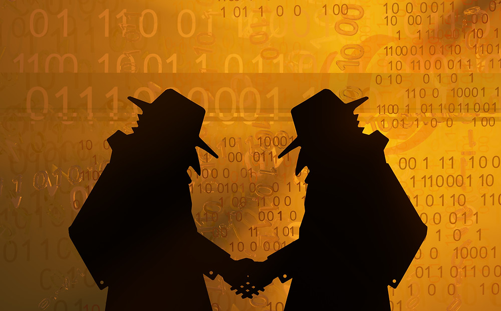 two shadowy figures shake hands