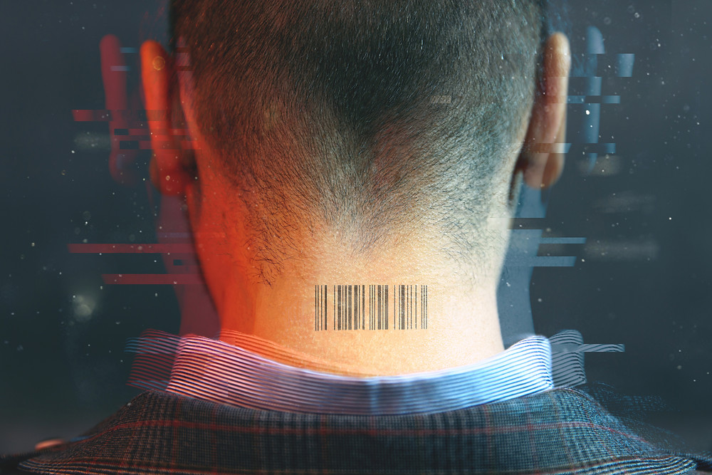 man with a barcode on the back of his neck