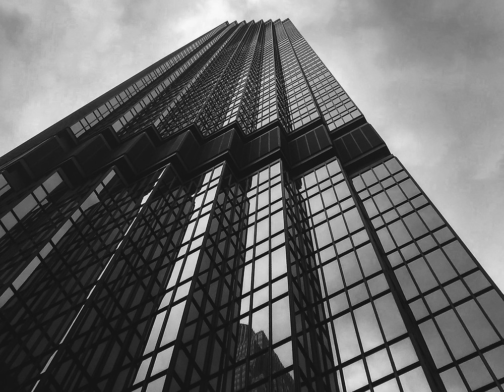black and white photo of a skyscraper stretching into the sky