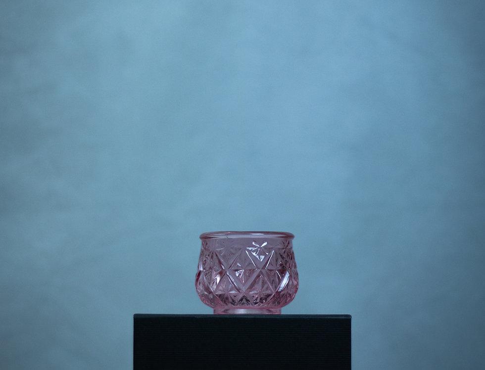 Pink cut glass tea light holder