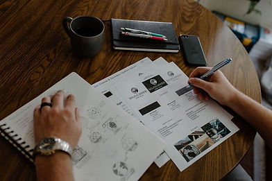 Person Sketching and Designing A Custom Brand Identity