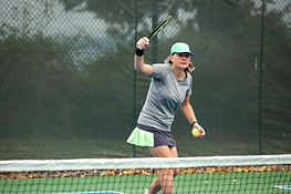 Female pickleball player on an outdoor c