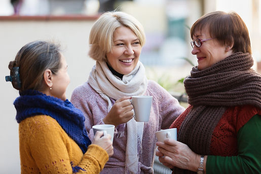 Smiling mature female in warm clothes ha