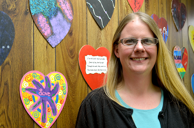 On Tuesday, April 5, 2016, Janelle Williams, the executive director of Audrain County Crisis Intervention Services in Mexico, Missouri, stands in front of the artwork made in therapy. Having been with ACCIS for nine years, Williams began an art therapy group to help sexual assault victims at their center work through their personal experiences.