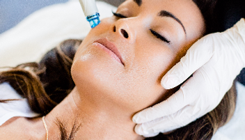 A woman undergoing hydrafacial treatment in Oxford