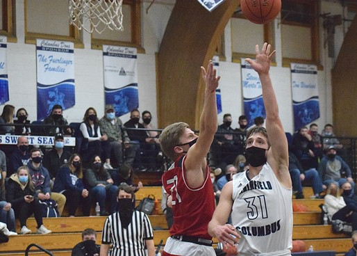 NEILLSVILLE BOYS BASKETBALL EDGES COLUMBUS CATHOLIC IN OVERTIME