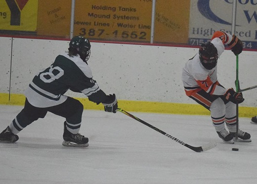 MARSHFIELD BOYS HOCKEY USES BIG SECOND PERIOD TO PULL PAST D.C. EVEREST