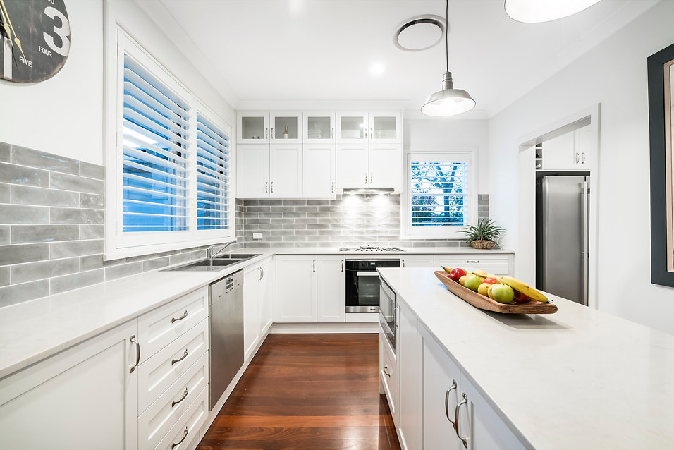 Hampton style kitchen design in white colour and stone benchtop in Perth