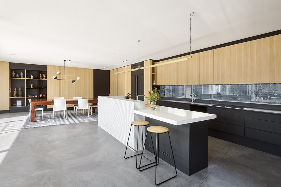 Contemporary kitchen cabinet design using two different colours for base and wall cabinets with Caesarstone benchtop and cabinet recessed lights in Perth