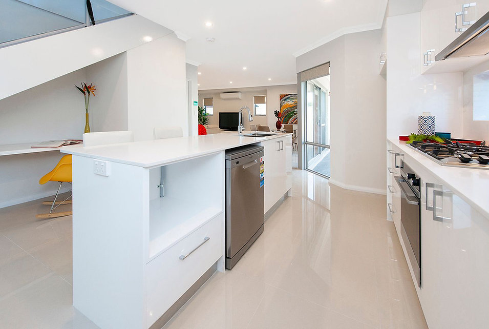Modern kitchen cabinets in white colour and white stone bench top with silver colour kick boards in Kewdale, Perth