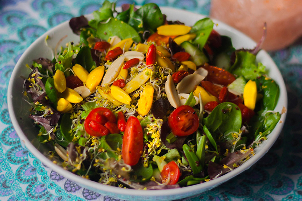 Raw superfood salad with pili nuts
