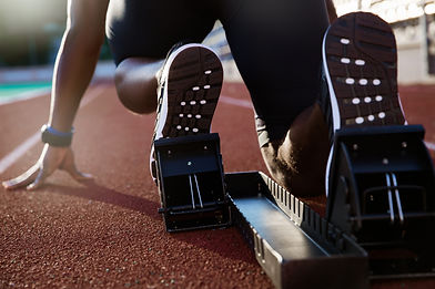 Back view of men's feet on starting bloc
