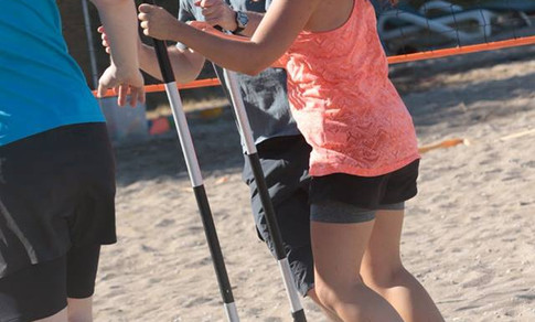 Coaching a fun warm up before a paddleboard fitness session
