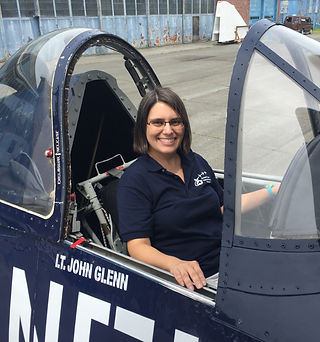 Donna Esposito in the cockit of an F4U Corsair