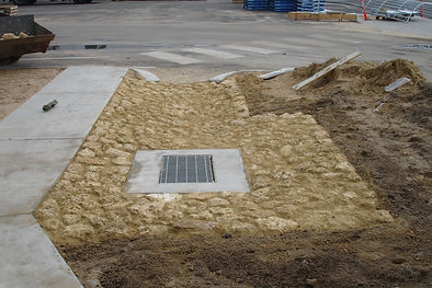 Limestone Rock stone pitching for culvert drain with concrete footpath