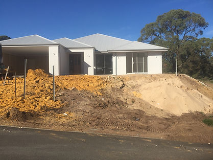 Front yard in Mylup Western Australia that requires a 1.8mtr high retaining wall to retain soil from eroding away.