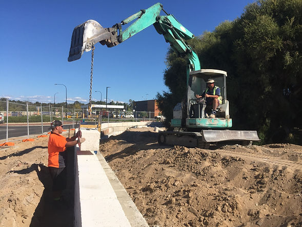 CONSTRUCTION OF DALYELLUP BOULEVARD ENTRANCE RETAINING WALL WITH IHI EXCAVATOR