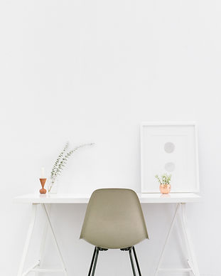 beige-and-black-chair-in-front-of-white-