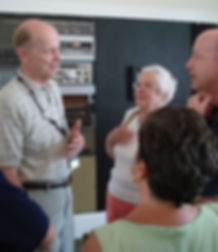 People listening to volunteer at CMMC.
