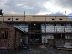 Oak frame clad in SIP roof Panels