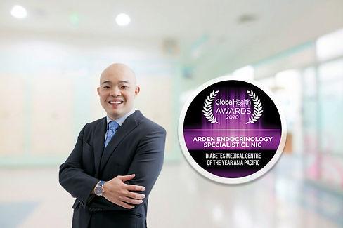 Dr Ben with round Awards.jpg