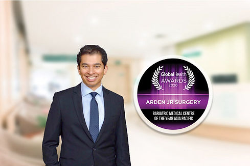 Dr Rao with Round Awards.jpg