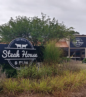 No Bull Steak House and Pub Outside signs, building advertising