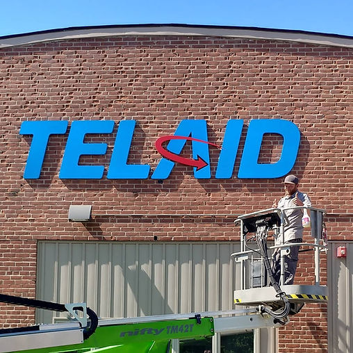 Telaid wall sign