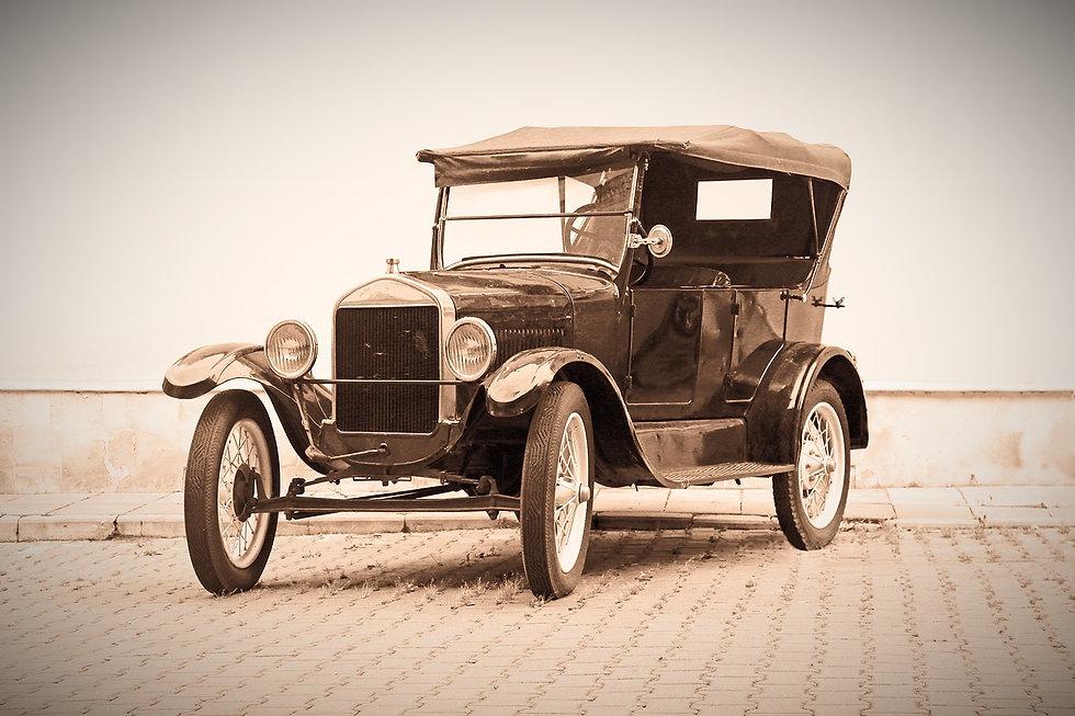 AdobeStock-old-car-cut%20out%20sky-279379737_edited.jpg