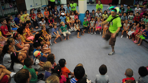 Bruce moves and grooves at the daily camp openings