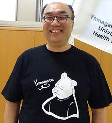 平山先生 顔写真(会長Tシャツ).jpg