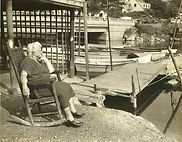 091 Nellie in Rockin Chair next to pier with boats 1200 dpi JPEG.jpeg