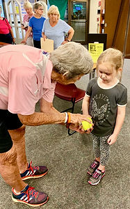 Joan Joyce showing Little Girl how to pi
