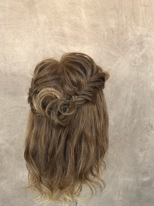 Formal hair style with fishtail braid