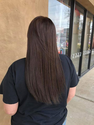 Chocolate brown tape-in extensions