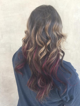 Color melt hair extensions with pops of red hilights