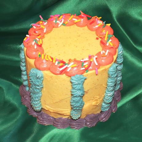 """4"""" vanilla cake raspberry jam butterscotch crunch pistachio butter cream"""