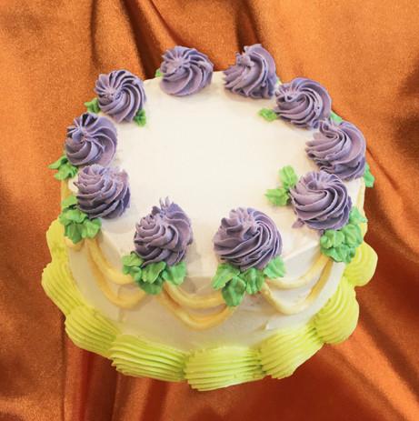 "6"" vanilla cake sunbutter mousse licorice praline vanilla buttercream"