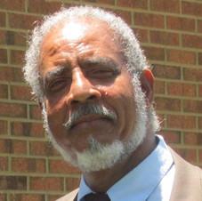 Dad head shot brick background plain.jpg