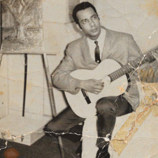 Dad and his guitar as young man_cropped.jpg