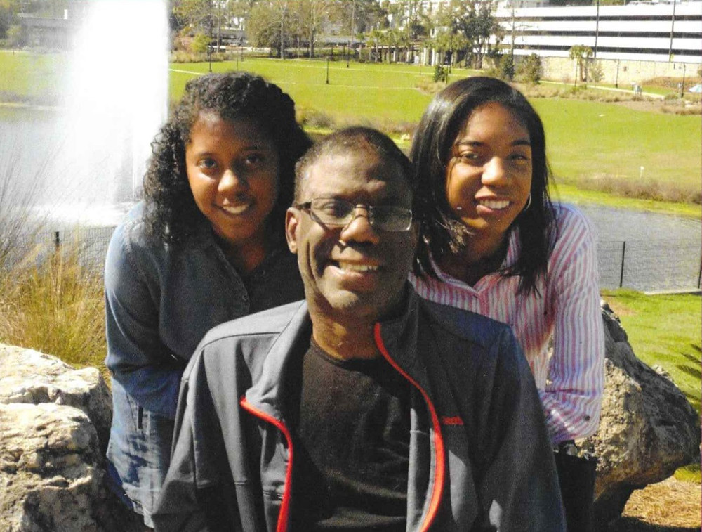 Tajah (left) with her sister and father