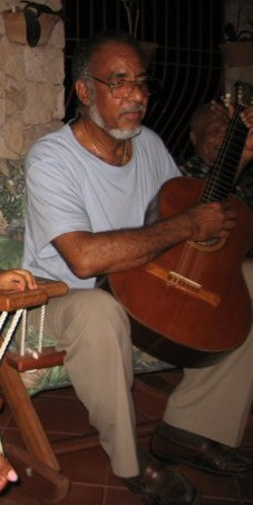 Dad and guitar Madou's house 2008_edited.jpg